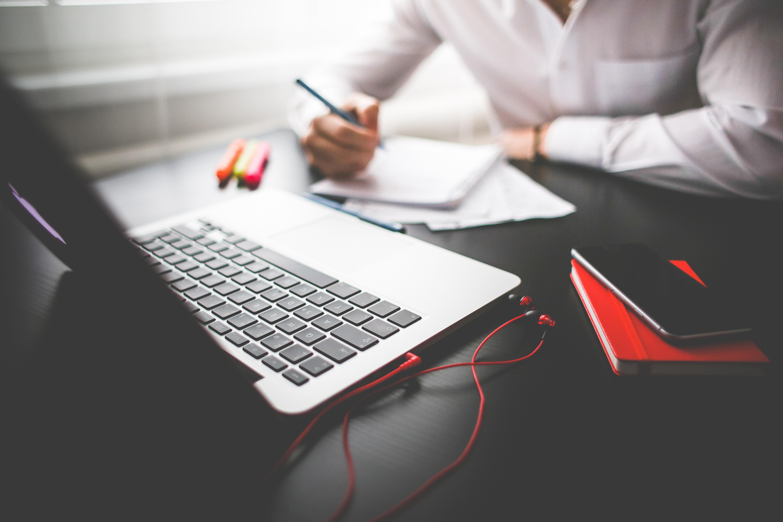 entrepreneur-working-on-his-macbook-picjumbo-com.jpg